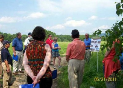 EC President/CEO Mike Dziak (left of poster) discusses an EPA funded silt pond reclamation project for which EC partnered with the Chesapeake Bay Foundation to use chicken manure-based compost as a soil additive. Attendees were professors in PSU's College of Agricultural Sciences.