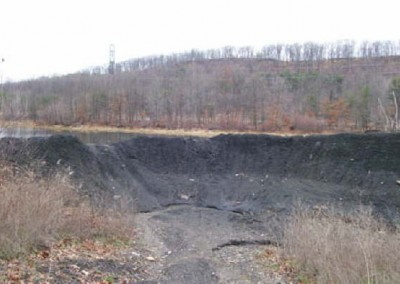 The EC Silt Pond Reclamation Project remediated an area where mining refuse had been stored and a pond formed.