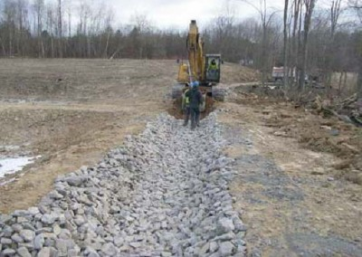 The stone culvert channels cleaned water from the settling ponds of the passive wetland treatment system and directs it into Espy Run creek.