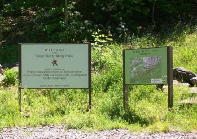 The Sugar Notch Trail System has a welcom sign and large scale trail map.
