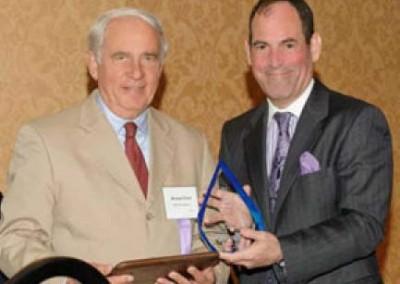 EC President & CEO Mike Dziak (left) is presented the Northeast PA Environmental Partners 2012 Award by PA DEP Secretary Michael Krancer.